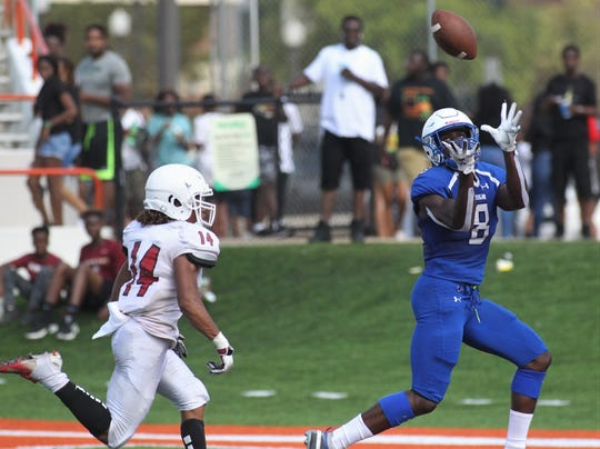 Godby junior receiver Avery Boyd hauls in a deep touchdown catch as the Cougars beat Leon 34-21 during the Big Bend Spring Football Classic jamboree at Florida A&M's Bragg Memorial Stadium on May 18, 2019.