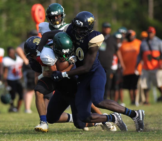 St. John Paul II defensive end Travis Mitchell makes a tackle as FAMU DRS beat St. John Paul II 30-0 during a spring football scrimmage on May 17, 2019.