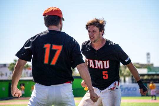 FAMU catcher Bret Maxwell (5) celebrates with Jake Lister between innings. Maxwell hit a two-run single with two out in the ninth to give the Rattlers a 5-4 win over Norfolk State in the opener of the MEAC Baseball Championship Game on Saturday, May 18, 2019 at Jackie Robinson Ballpark in Daytona Beach.