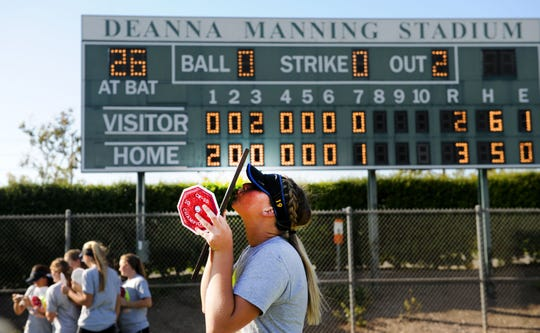 Sydnie Wimpee kisses the championship plaque after leading Nordhoff to a 3-2 win over Garden Grove-Santiago in the CIF-Southern Section Division 6 championship game at Manning Stadium in Irvine on Friday.