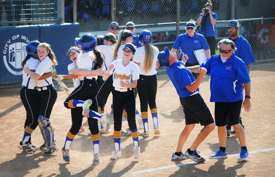 The Nordhoff High softball team celebrates its 3-2 win over Garden Grove-Santiago in the CIF-Southern Section Division 6 championship game at Manning Stadium in Irvine on Friday.