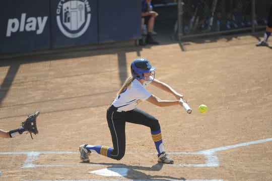 Nordhoff's Zoe Damianos drops down a bunt against Garden Grove-Santiago in the CIF-Southern Section Division 6 title game at Manning Stadium in Irvine. Nordhoff won 3-2.