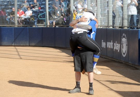 Senior Sydnie Wimpee hugs her father Jacob Wimpee after leading the Nordhoff High softball team to the program's first CIF-Southern Section championship on Friday at Manning Stadium in Irvine.
