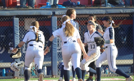The Central Valley Christian High School softball team celebrates after winning the 2019 Central Section Division VI championship on Friday at Fresno State's Margie Wright Diamond.