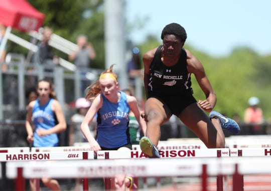 New Rochelle's Chiamaka Odenigbo competes in the 100-meter hurdle preliminaries during the Westchester County Track & Field Championships at Harrison High School in Harrison on Saturday, May 18, 2019.