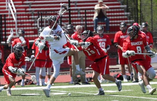 Fox Lane defeated Somers 12-10 in boys lacrosse playoff action at Fox Lane High School in Bedford May 18, 2019.