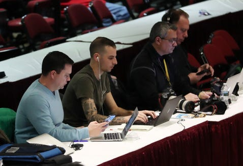 (from left) Journal News/lohud staffers Josh Thomson, Mike Zacchio and John Meore working a playoff game at the Westchester County Center.