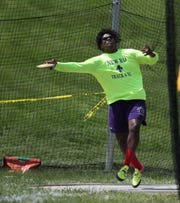New Rochelle's Jordan Forrest throsw the discus during the Westchester County Track & Field Championships at Harrison High School in Harrison on Saturday, May 18, 2019.