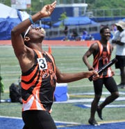 Zahmeire  Lewis of A.I. du Pont celebrates after crossing the finish line at DIAA track championships.