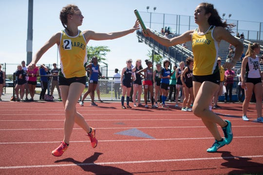 High School athletes compete in the DIAA Track & Field State Championships Friday afternoon at Dover High School.