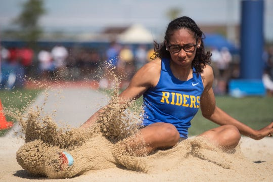 Caesar Rodney's Destiny Bailey-Perkins competes in the DIAA Track & Field State Championships at Dover High School.
