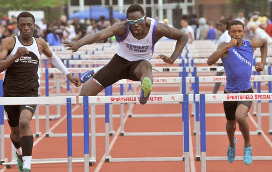 Howard's Isiah Kelsey clearing the last hurdle to win the Division II championship with a time of 14.96.