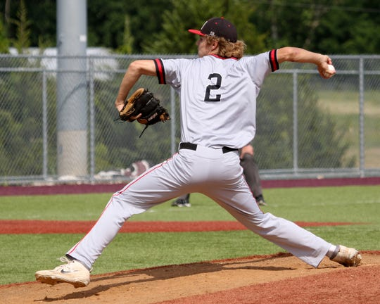 Muenster's Danny Luttmer pitches against Windthorst Friday, May 17, 2019, in Bowie.
