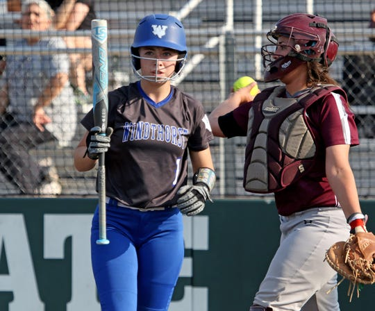 Windthorst's Kora Pennartz looks to head coach Alyson Deatherage in Gm 1 against Ralls Friday, May 17, 2019, at Midwestern State University's Mustangs Park.