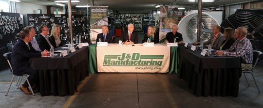 Vice President Mike Pence, center, and Stephen Censky, left center, Deputy Secretary of the U.S. Department of Agriculture, hold a roundtable discussion with area business leaders and legislators while visiting J&D Manufacturing in Eau Claire, Wis., on Thursday, May 16, 2019.