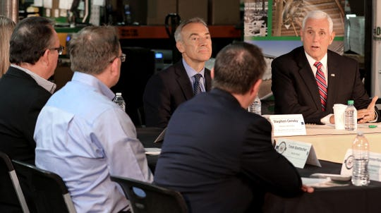 Vice President Mike Pence, right, and Stephen Censky, center, Deputy Secretary of the U.S. Department of Agriculture, hold a roundtable discussion with area business leaders and legislators while visiting J&D Manufacturing in Eau Claire, Wis., on Thursday, May 16, 2019.