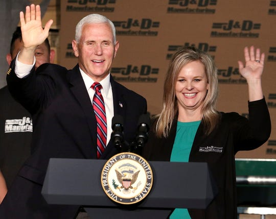 Vice President Mike Pence greets the audience with J&D Manufacturing president and co-owner Tracy Trippler in Eau Claire, Wis., Thursday, May 16, 2019.
