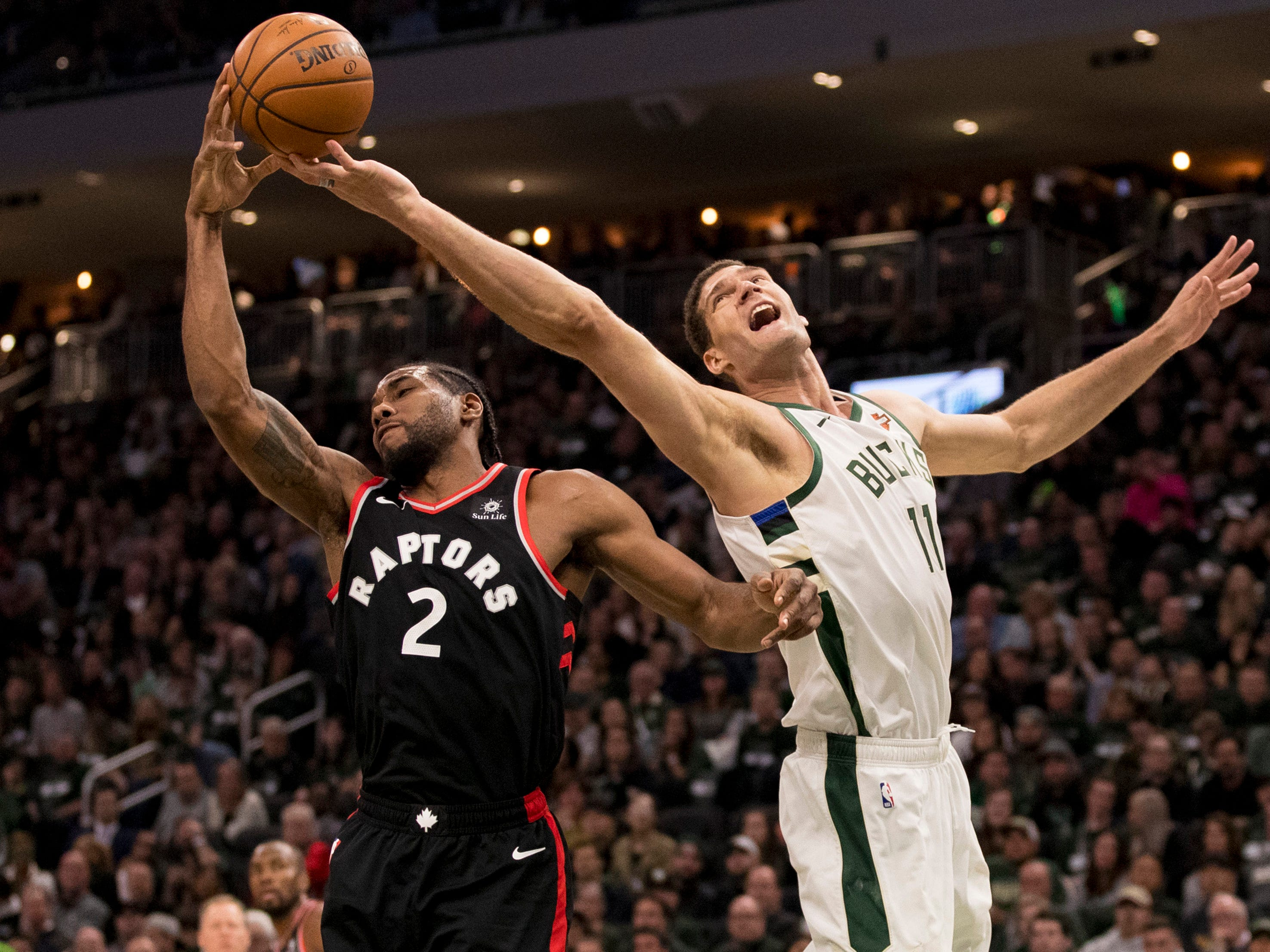 May 17:  Raptors forward Kawhi Leonard (2) vies for a rebound against Bucks center Brook Lopez (11) during Game 2.