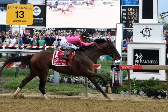 War of Will, ridden by Tyler Gaffalione, crosses the finish line first to win the Preakness Stakes.