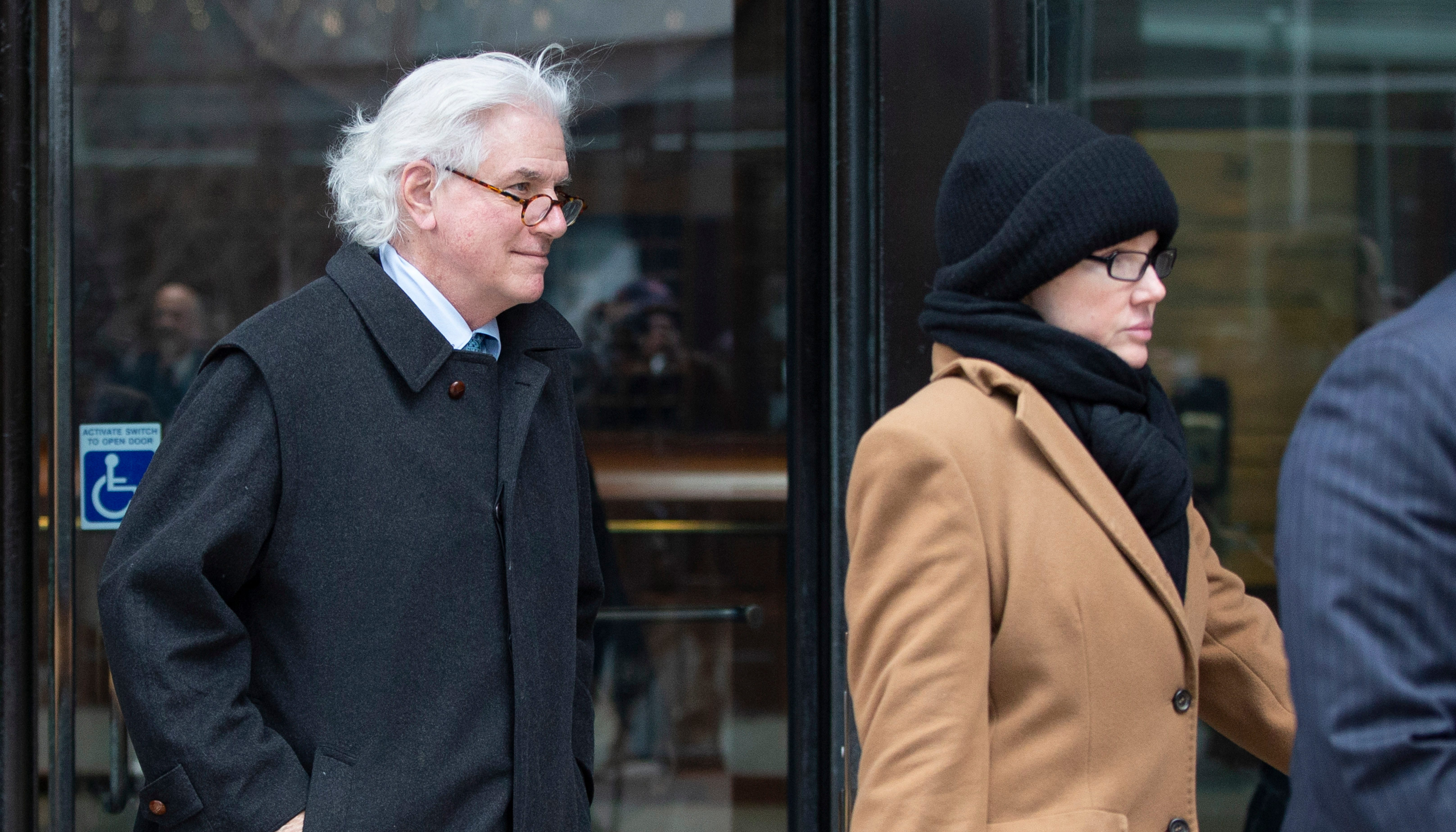 epa07471635 Gregory Abbott (L) of New York, and his wife, Marcia Abbott (R) leave the John J Moakley Federal Court House after entering a plea for their part in the college admissions scandal in Boston, Massachusetts, USA, 29 March 2019. EPA-EFE/CJ GUNTHER ORG XMIT: CJX14