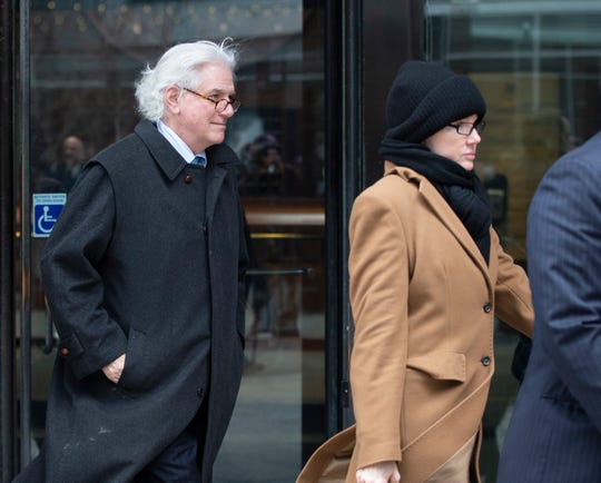 Gregory Abbott, left,of New York, and his wife, Marcia Abbott, right, leave the John J Moakley Federal Court House after entering a plea for their part in the college admissions scandal in Boston, Massachusetts, USA, 29 March 2019.