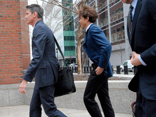 Napa Valley Vintner, Agustin Huneeus Jr., (C) makes his way to the John Joseph Moakley United States Courthouse to plea in front of a judge for charges in the college admissions scandal, on March 29, 2019, in Boston. (Photo by Joseph Prezioso / AFP)JOSEPH PREZIOSO/AFP/Getty Images ORG XMIT: Wealthy U ORIG FILE ID: AFP_1F81YH