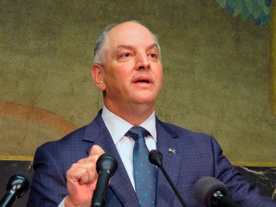 In this Thursday, Sept. 20, 2018 file photo, Gov. John Bel Edwards talks about an expected $300 million-plus surplus Louisiana will have from the last budget year in Baton Rouge, La. (AP Photo/Melinda Deslatte, File)