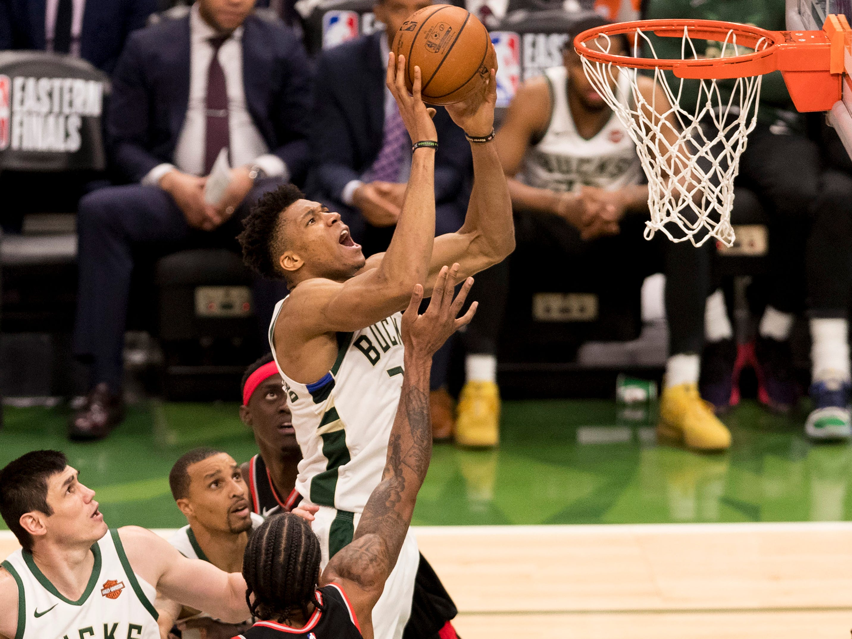 May 17: Bucks forward Giannis Antetokounmpo (34) drives to the bucket during Game 2 against the Raptors in Milwaukee.