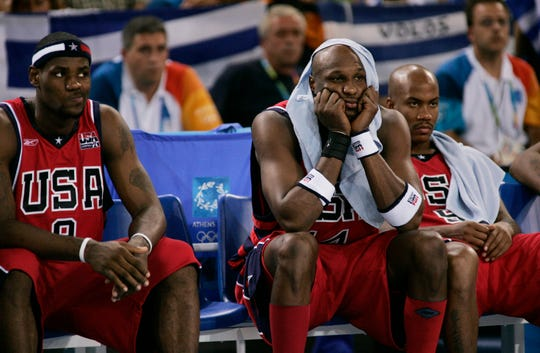 LeBron James, Lamar Odom and Stephon Marbury sit on the bench during the 2004 Olympics.