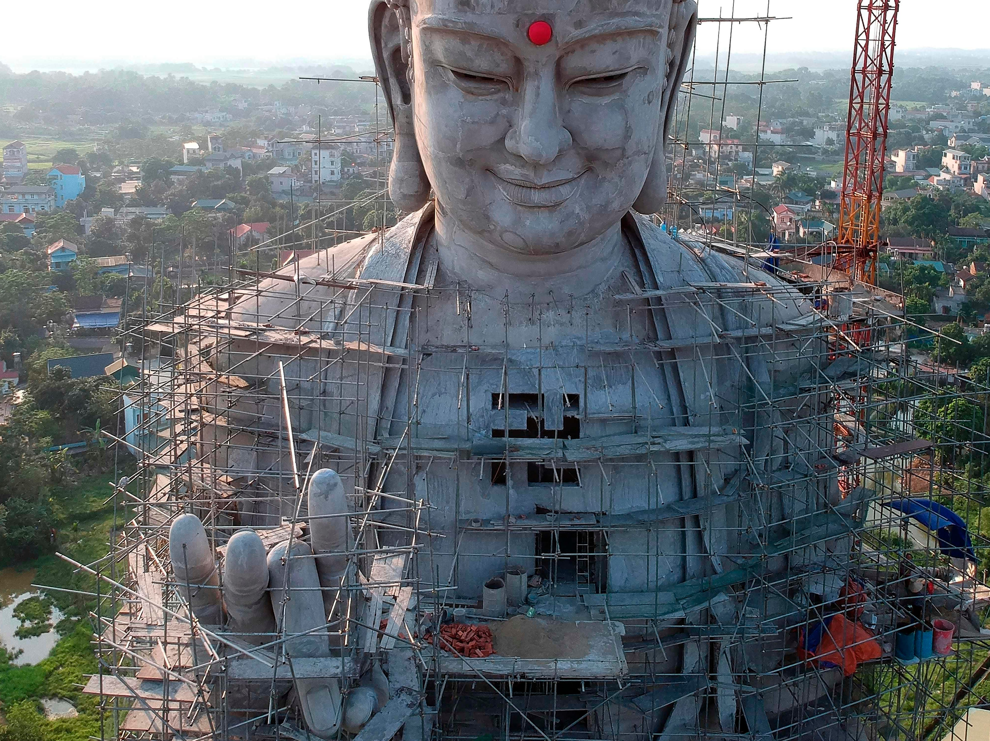 This aerial photograph shows a giant under-construction Buddha statue at Khai Nguyen pagoda in Son Tay on the outskirts of Hanoi on May 18, 2019 on the eve of Vesak day or Buddha day festival, marking the birth of Gautama Buddha, his attaining enlightenment, and his passing away.
