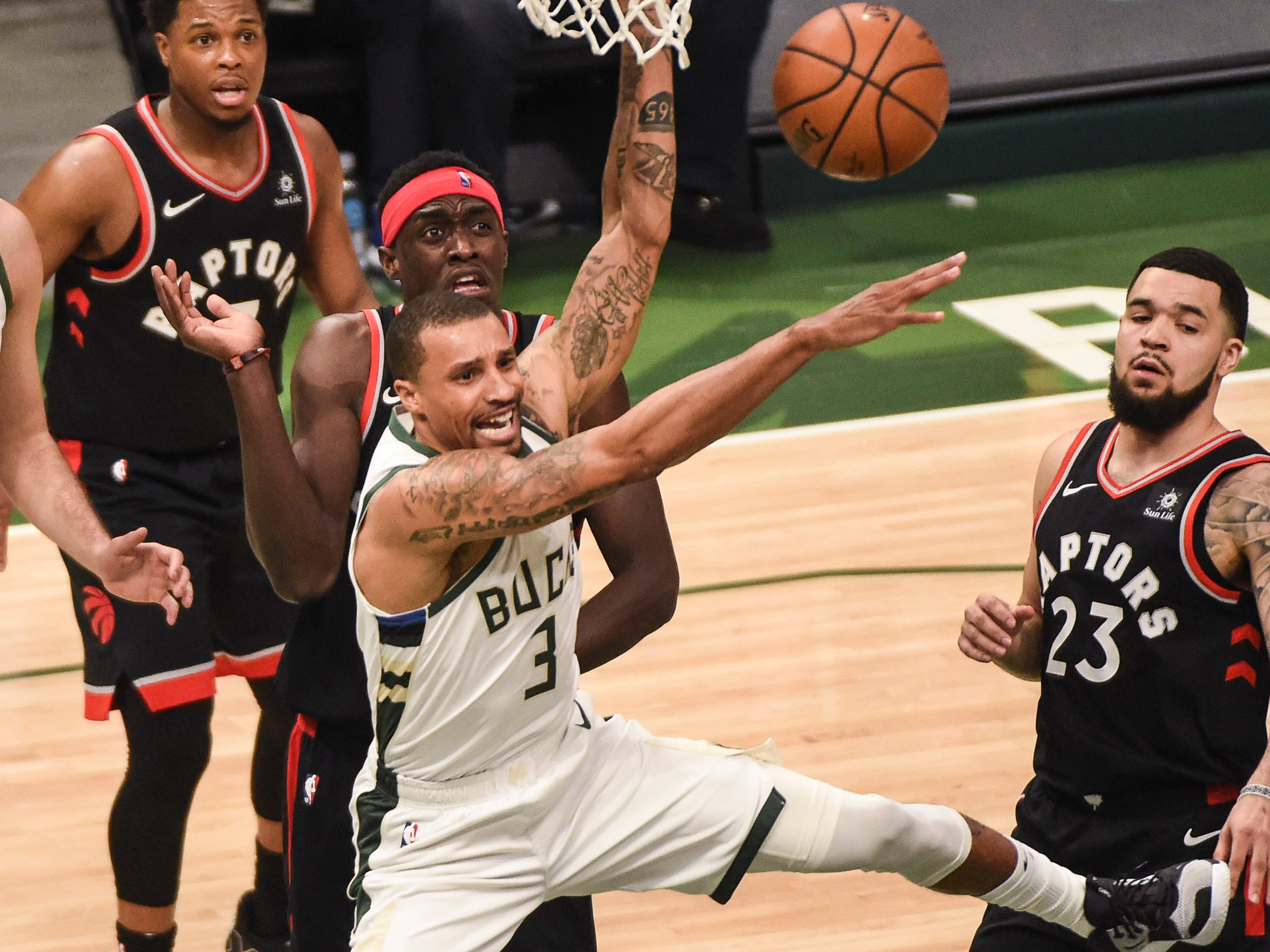 May 17: Bucks guard George Hill (3) loses control of the ball between Raptors defender Fred VanVleet (23) and Pascal Siakam (43) during Game 2