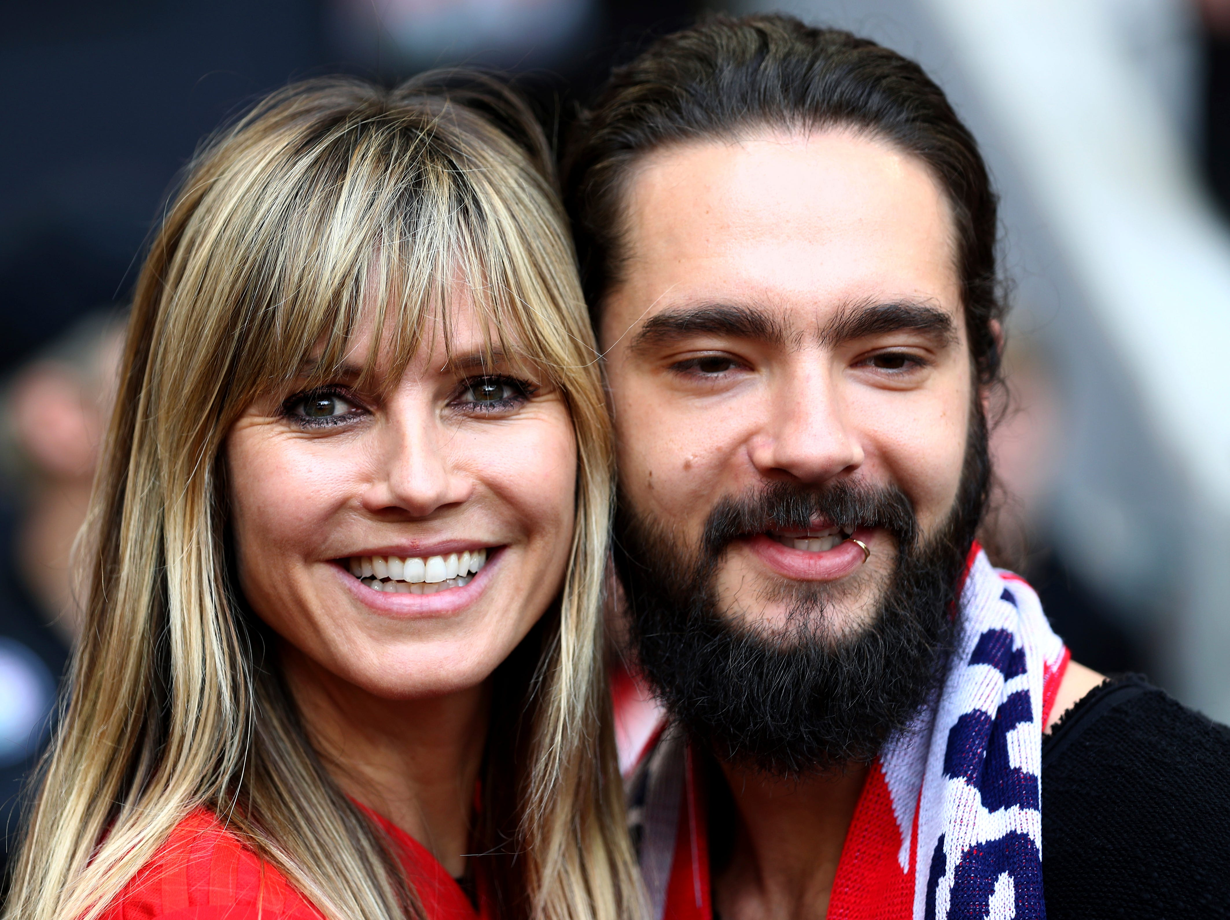 Former German model Heidi Klumm, left, and her partner and member of the band 'Tokio Hotel', Tom Kaulitz, right, pose for the media prior to the German Bundesliga soccer match between FC Bayern Munich and Eintracht Frankfurt in Munich, Germany, Saturday, May 18, 2019.