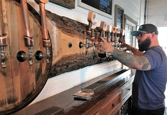 Will Meiron fills a double order at Sockdolager Brewing Co. on Saturday evening. The local brewhouse won a $100,000 award in the BE in Abilene competition.