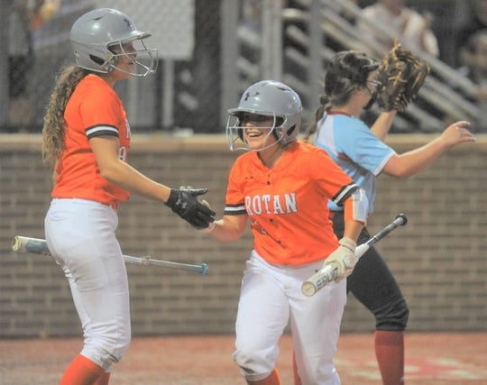 Rotan's Zoe Flores, right, high-fives teammate Ryleigh Denton after Flores scored in a Region I-1A final softball series against Gail Borden County on May 18, 2019, at First United Park in Lubbock.