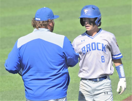 Brock's Jaxon Gleaton is greeted by the Eagles first base coach after hitting a two-run in the fifth inning for an 8-1 lead over Clyde. It ended up being the game-winning hit. Brock won the game 8-6 to sweep the Region I-3A quarterfinal playoff series Saturday, May 18, 2019, at ACU's Crutcher Scott Field.
