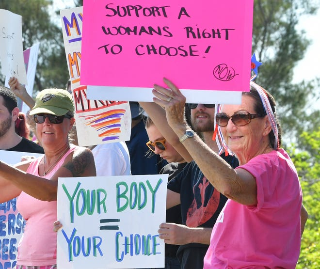 """A Sunday morning pro-choice rally organized by Brevard Women's March 2019 called """"Our Bodies, Our Choice"""" was held along the Eau Gallie Causeway. The abortion rights participants formed on the east side of the causeway on May 19 in several groups and walked over the bridge, holding signs protesting the recent pro-life legislation in several states."""