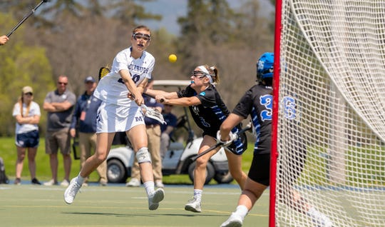 Burlington's Casey O'Neill fires a shot during Middlebury's 16-4 win over Franklin & Marshall in the NCAA Division III quarterfinals on Sunday.