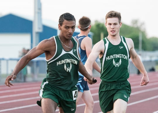 Huntington's Austin Holdren hands the baton off to anchor Canaan Knoles during the 4x400 meter semifinal race for the Division III district tournament at Southeastern High School on May 15, 2019, in Chillicothe, Ohio. Huntington would go on to win the finals with a time of 3:37.28 to qualify to compete in the Division III region 11 meet at Lancaster High School in Lancaster, Ohio, on May 22 and 24.
