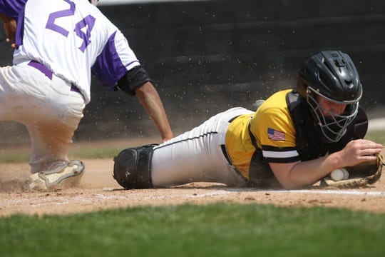 Mike Slover, of South Brunswick, holds onto the ball after Elliot Hayward, of Old Bridge slid home.  In a controversial call, the umpire called Hayward out, while some believed Slover did not have control of the ball. Sunday, May 19, 2019