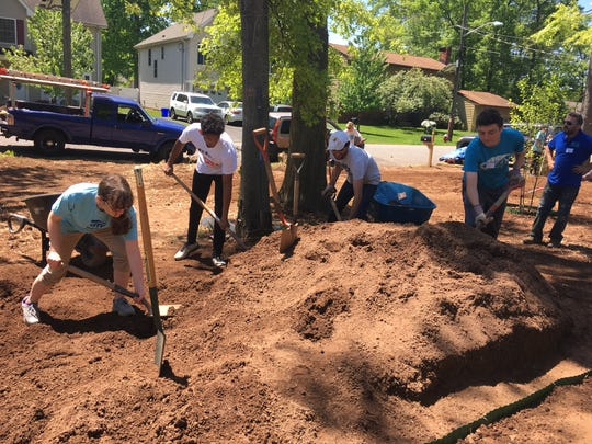 Students from area high schools working together on the front yard. (Left to right) Julia Spano, Raahil Gunaratne, Joe Napoli, Mike Salvo and Site Supervisor Adam Capone.