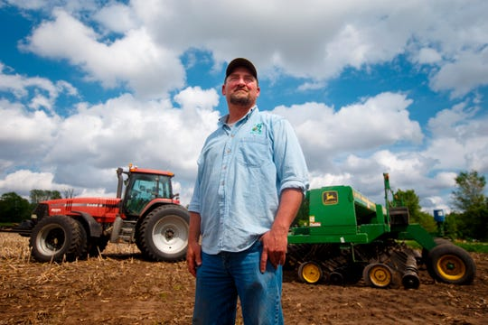Farmer Tim Bardole pauses for a photo as he plants a field near Perry, Iowa. Donald Trump won the presidency by winning rural America, in part by pledging to use his business savvy and tough negotiating skills to take on China and put an end to trade practices that have hurt farmers for years. While the prolonged fight has been devastating to an already-struggling agriculture industry, there's little indication Trump is paying a political price.