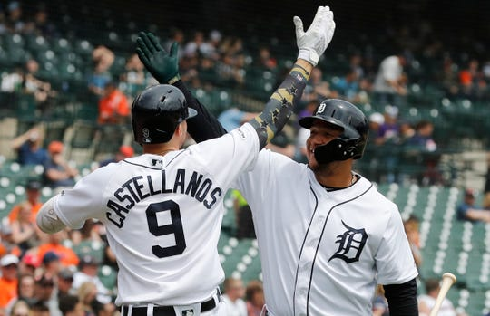 Nicholas Castellanos exchanges a high-five with Miguel Cabrera after hitting a solo home run during the third inning.