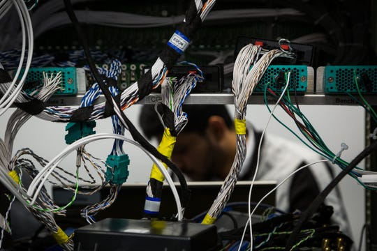 Sai Pappu performs testing at the Electronics Lab Friday, February 2, 2018, in the Alternative Energy Center at the General Motors Technical Center in Warren, Michigan. (Jeffrey Sauger for General Motors)