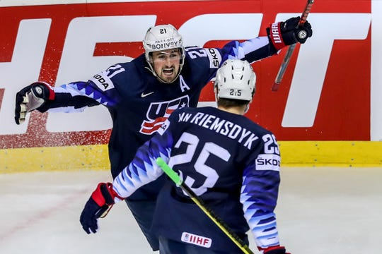 Dylan Larkin celebrates his goal with U.S. teammate James van Riemsdyk during the Group A match against Germany in Kosice, Slovakia on Sunday.