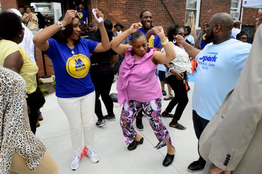 Rhonda Love of Detroit dances at the official opening of the Dancing in the Street park during the annual Founder's Day event at the Motown Museum in Detroit on Sunday, May 19, 2019. The new public space is located on the grounds of the Motown Museum.