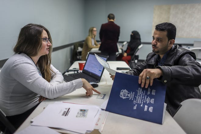 Volunteer Attorney Tania Morris Diaz, of Michigan Immigration Rights Center, works with Hameed Ali Al-Sobhi, 33, of Hamtramck, on his citizenship application, during the Detroit New Americans campaign's citizenship workshop at the Yemeni American Leadership Association in Hamtramck, Mich. on Friday, April 26, 2019.