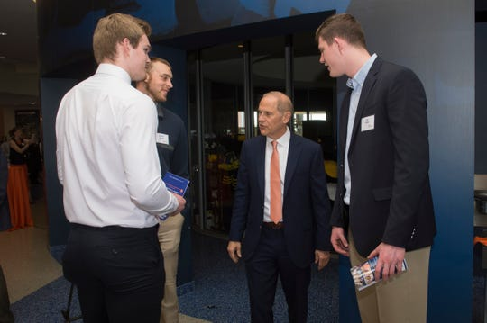 Former Michigan basketball coach John Beilein talks with players (left to right) Austin Davis, Jaron Faulds and Jon Teske during the third annual Champions for Change gala at Crisler Center in Ann Arbor on Saturday, May 18, 2019.