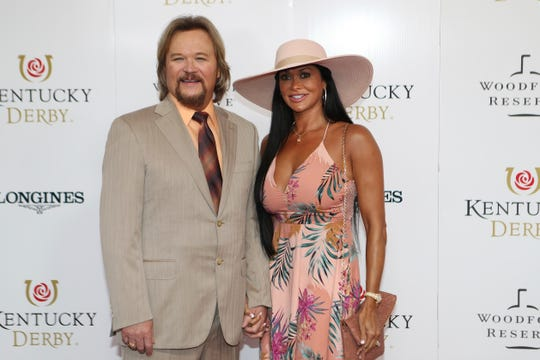 Travis and Theresa Tritt walk the red carpet before the 145th running of the Kentucky Derby horse race at Churchill Downs Saturday, May 4, 2019, in Louisville, Ky.
