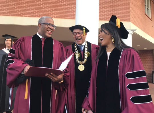 Robert F. Smith, left, laughs with David Thomas, center, and actress Angela Bassett at Morehouse College on Sunday. Smith, a billionaire technology investor and philanthropist, said he will provide grants to wipe out the student debt of the entire graduating class at Morehouse College - an estimated $40 million.