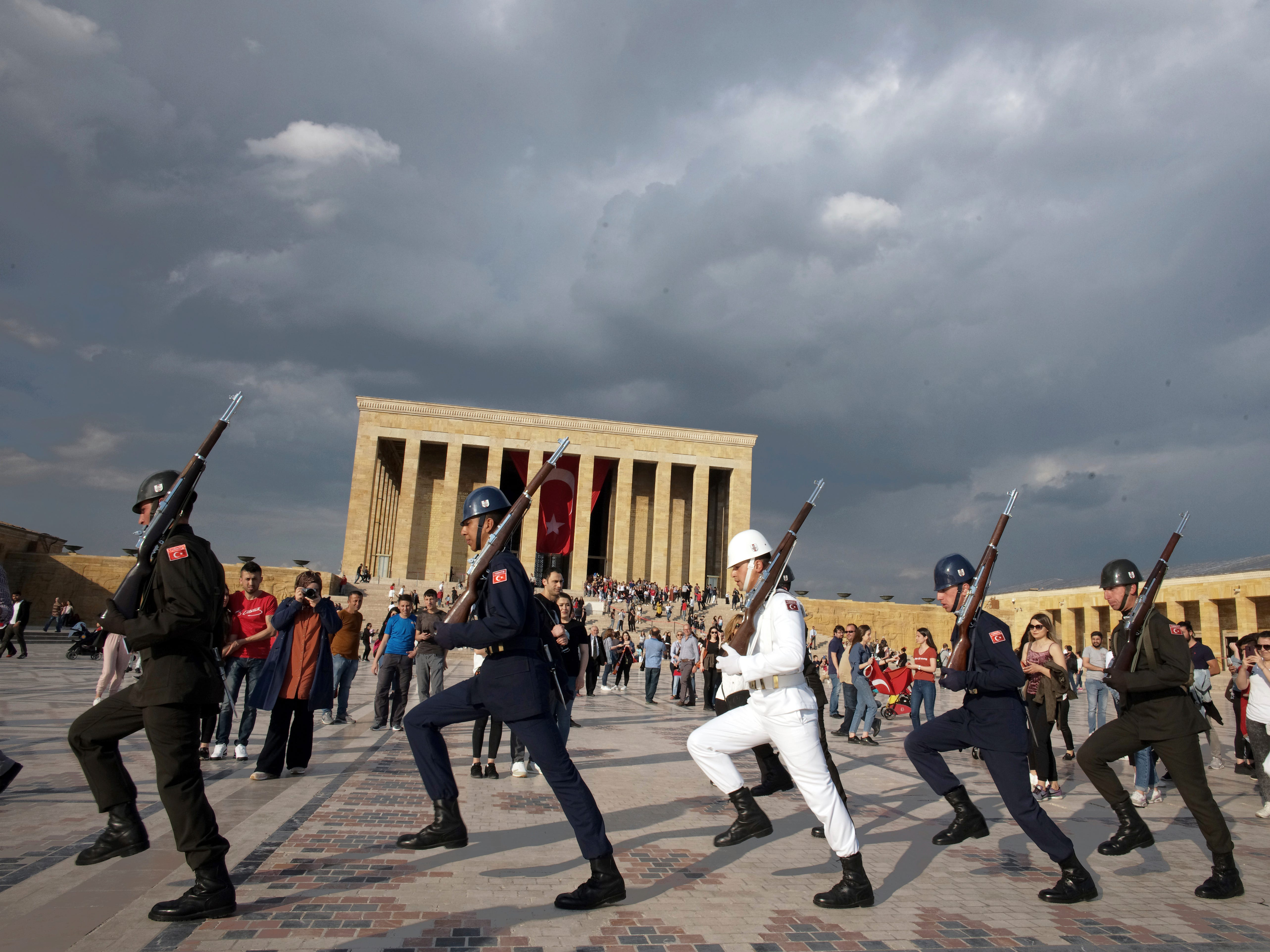 Soldiers march during a changing of the  guard ceremony as thousands of people visit the mausoleum of Mustafa Kemal Ataturk, the founder of modern Turkey. The day marked the 100th anniversary of the start of Turkey's War of Independence under the leadership of young Ottoman army general, Mustafa Kemal (Ataturk), 38, in Ankara, Turkey, Sunday, May 19, 2019.